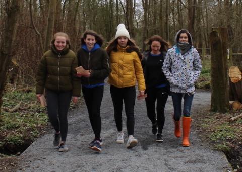 Girls walking in woods
