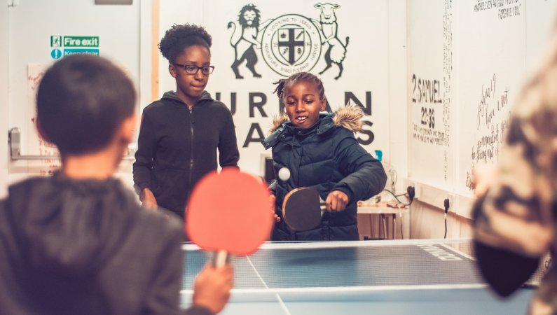 Young people playing table tennis at a local weekly Urban Saints Group