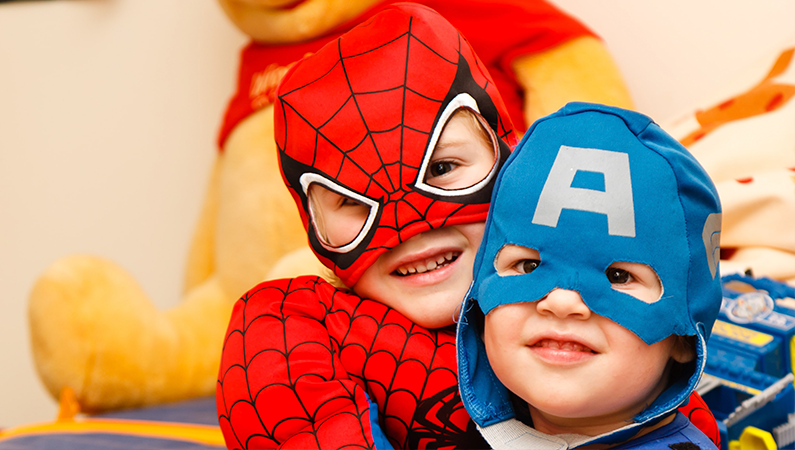 Be A Hero to help us keep reaching heroes like these children - Christmas party heroes