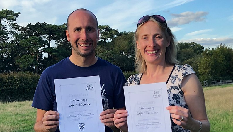 Ian and Alison Mitchell - among a whole load of new Honorary Life Members of Urban Saints - holding their certificates, in recognition of many year's service to the mission