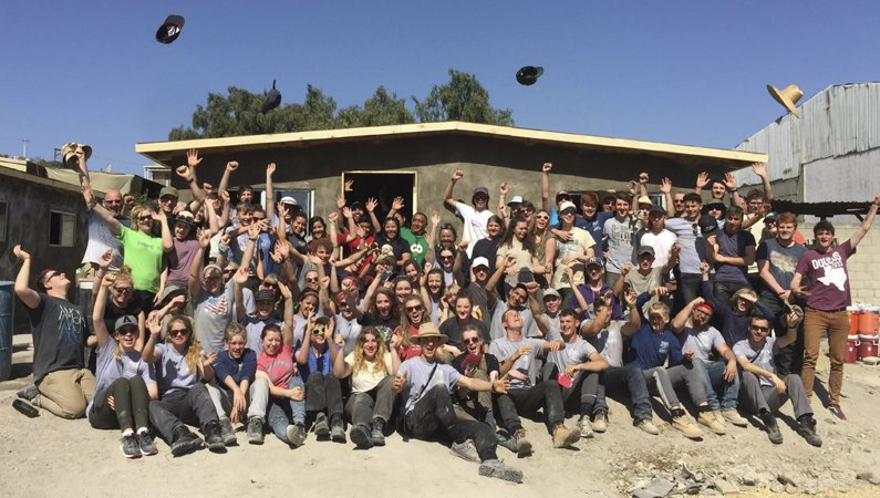 An Overseas Adventures group celebrating a house built for a struggling family in Mexico