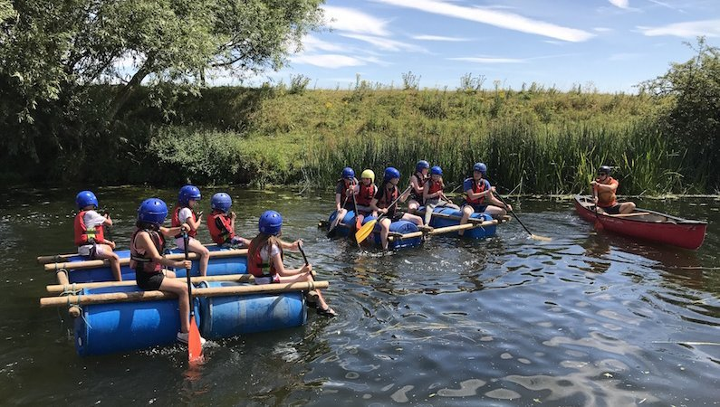 Young people enjoying rafting at Spree Central at Rock UK's Frontier Centre