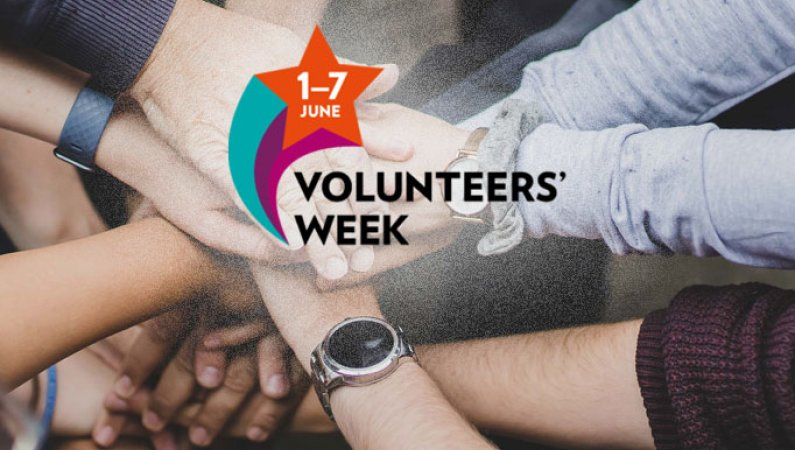 The Volunteers Week 2021 logo overlaid on a group of hands held together